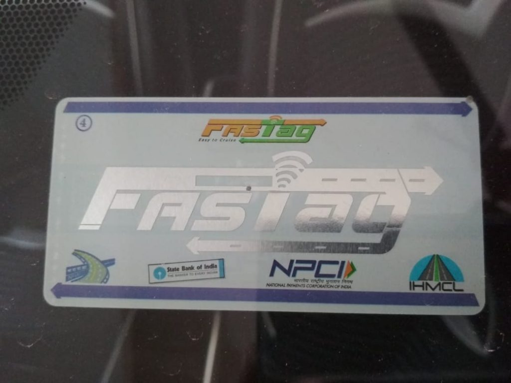 FASTag sticker on vehicle windscreen